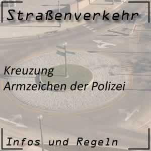 Armzeichen der Polizei bei Kreuzungen